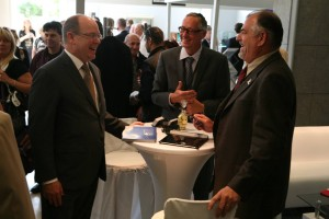Eric Eckardt (center) shares a laugh with Prince Albert II (left) at the Top Marques Monaco