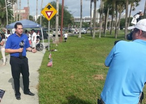 Immigration Rally Sarasota.Reporter Max Winitz (cropped)
